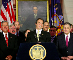 Gov. Andrew Cuomo announcing new ethics law for public officials, June 2011, official photo.