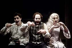 Dave Droxler as Gwynplaine, Jon Froehlich as Ursus, Molly O'Neill as Dea, photo Carrie Leonard.