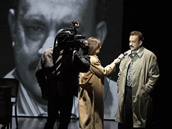 Deirdre Lovejoy as TV reporter interviewing Tom Hanks as McAlary on his big scoop, photo Joan Marcus.