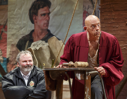 Tom Riis Farrell and Christopher Lloyd as Azdak, the judge, photo Joan Marcus.