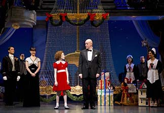 Lilla Crawford as Annie, Anthony Warlow as Daddy Warbuck and the servants, photo Joan Marcus.