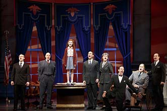 Lilla Crawford as Annie, and FDR (Merwin Foard) and his cabinet, photo Joan Marcus.