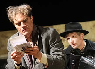 Michael Shannon as Berenger looking at phots of colonel with Paul Sparks as Edward, photo Gerry Goodstein.
