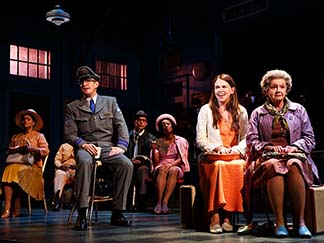 Sutton Foster as Violet and the cast, waiting at a bus station, photo Joan Marcus.