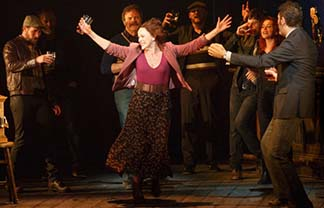 Sally Ann Triplett as Peggy, wife of the workers' leader, in women's number, photo Joan Marcus.
