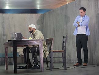 Usman Ally as Bashir and Justin Kirk as Nick, for front, photo Joan Marcus.