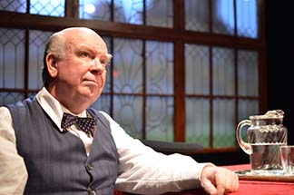 Ronald Keaton as Winston Churchill at table, photo Jason Epperson.
