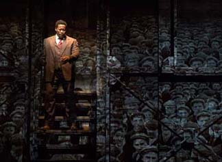 Daniel Beaty as Paul Robeson, background is miners' march, photo Max Gordon.