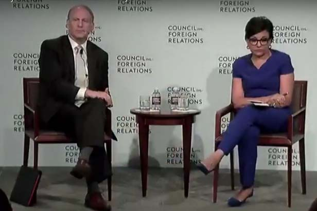 Richard Haass and Penny Pritzker listen to the question on TPP.