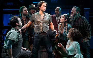 Steven Pasquale as Jamie Lockhart and the company, photo Joan Marcus.