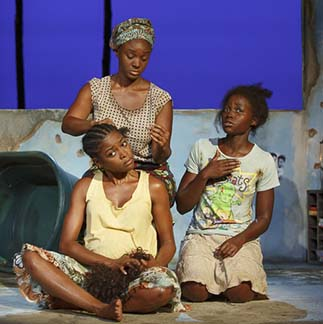 Pascale Armand as Wife #3, Saycon Sengbloh as Wife #1 and Lupita Nyong'o as the Girl, photo Joan Marcus.
