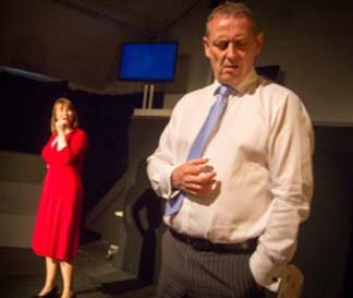 Suzie Marshall as Claudia Roe and Colin McPherson as Jeffrey Skilling, photo Richard Croasdale.